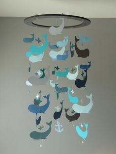 Hand-made Whale Mobile... nautical/under the sea would be a really cool, different theme for a nursery.