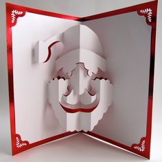 Santa Claus Christmas Pop Up Card Home Décor 3D Handmade Cut by Hand Origamic Architecture in Metallic Bright Red and White.. $15.00, via Etsy.