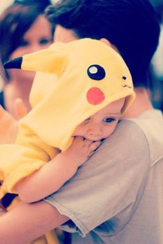 This baby is so cute with his little pikachu hoodie !!!!!!!!