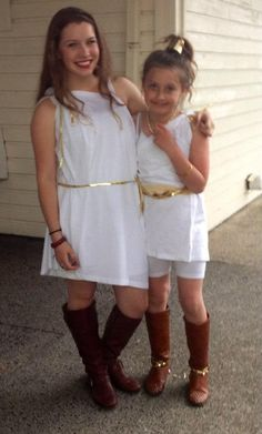 Elegent and appropriate look for young Toga costumes..on a budget friendly level.  Extra Large t-shirts with one arm pulled out of sleeve for off the shoulder look and inexpensive gold accessories.  Everyday brown boots finalize the look for an innocent and elegent costume for Toga Party.