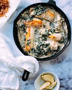 """This fish dinner was one of my favourite things I've made recently. The sauce is just tahini, garlic and lemon juice, the haddock takes just a quick sear in a hot pan, and wilted kale sops up the creamy liquid. Fried shallots and crunchy toasted pine nuts totally guild the lily.We were talking about """"resolutions"""" last time you were here. I use bunny ears around the word because I don't make actual resolutions, but I do make reflections. I have another one for you that's ..."""