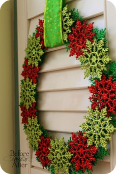 This would be really easy... Dollar store snowflakes and a foam wreath form!