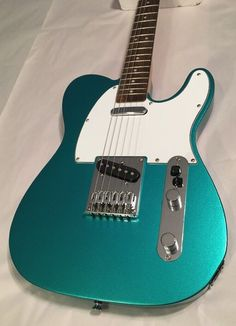 Squier Affinity Series Telecaster Electric Guitar In Race Green teal blue Fender Stratocaster, Squier Affinity Telecaster, Fender Guitars, Gretsch, Ovation Guitars, Acoustic Guitars, Guitar Tips, Guitar Lessons, Cheap Guitars
