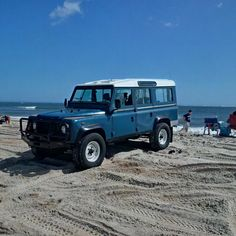 Land Rover Defender 110 Td5 Sw in sand beach journey.