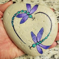 Painted stone Dragonflies - heart - takeabreak The Effective Pictures We Offer You About beach Stone A quality picture can tell you many things. Dragonfly Painting, Dragonfly Art, Heart Painting, Pebble Painting, Pebble Art, Stone Painting, Body Painting, Painted Rock Animals, Painted Rocks Craft