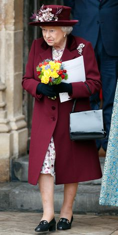 MAROON - March 2018. The queen wore a maroon coat with a darker lapel and matching floral-embellished hat to the 2018 Commonwealth Day service at Westminster Abbey.