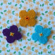 "Plastic Canvas: Mini Flower and Flower Pot Magnets, set of 6 (closeup of the 3 flower magnets) -- ""Ready, Set, Sew!"" by Evie"