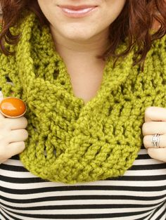 Looks like chunky yarn, an N hook and treble crochet in a mobius strip.