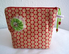 Cosmetic bag. Decorated with selfmade fabric flower und beads. USA Designer fabrics