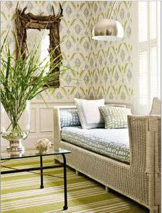 from Apt Therapy - I'm not typically very much into wallpaper, but this I like.  And the wicker day bed is a bonus!