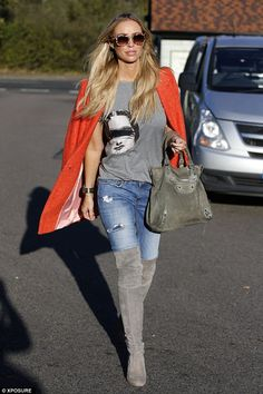 She's in fashion: Lauren Pope looks lovely in orange after filming scenes for reality show...