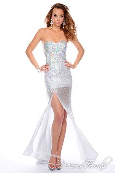 Precious Formals Style P55243 Iridescent rectangular beads form linear designs along the sweetheart neckline and bodice of this sequined gown, which also features a sheer-paneled slit.
