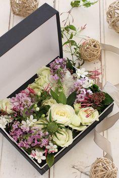 Box flower arrangement for you .