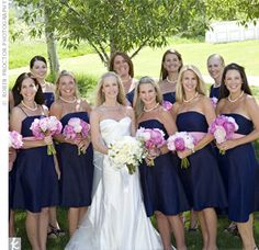 pic of how a large bridal party photographs with navy dresses with pink/white accent flowers. looks great!