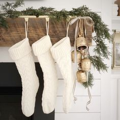Minimal Christmas Mantel - The Coastal Oak Minimal Christmas decor on a shiplap fireplace mantel, with cedar garland, knit stockings, simple ribbon, and harmony be. Merry Little Christmas, Cozy Christmas, Rustic Christmas, Simple Christmas, Christmas Holidays, White Christmas Stockings, Christmas Trees, Christmas Villages, Victorian Christmas