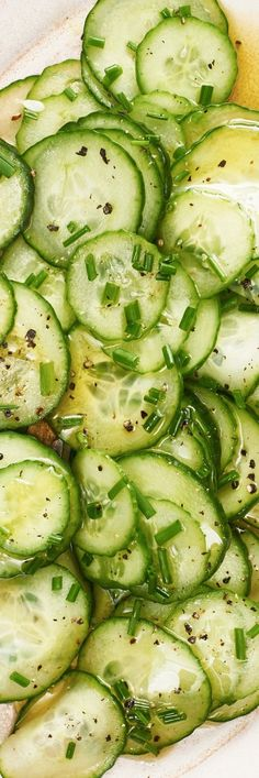 This easy quick pickled cucumber salad is the simple summer side your dinner is missing. Pairs perfectly when served with grilled meats like chicken, fish, pork, fish, and beef. You'll need cucumbers for this recipe, sugar, vinegar, green onions, olive oil, black pepper, and salt. Side dishes like this are healthy, vegetarian, light, and fast. Here's how to make it!