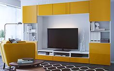 Same room, same pieces, a pop of yellow accents on the wall units bring even more sunshine inside lighting up the media center, giving a more direct focus