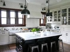 Still the reigning design style, the timeless look of traditional kitchens speaks to most of us. Cabinets can be painted or stained, and glass-front doors are a popular option, as are multipurpose islands. The best traditional kitchens pull in classic elements without looking too stodgy or trapped in a time warp. Keep the look fresh by mixing in modern or industrial elements like these patinated lighting fixtures or streamlined barstools. Design by Rebekah Zaveloff