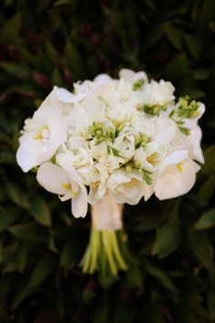 Gorgeous white tropical bouquet by Elena Damy, photo by Chris + Lynn Photographers | via junebugweddings.com