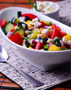 Marinated vegetable salad with tomatoes, peppers, cucumber, red onions and feta cheese
