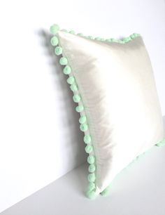 Ivory Silk Mint Green Pom Pom Square Cotswold Cushion - Angle