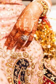 Engagement Rings - WedMeGood   Beautiful Diamond Solitaire Ring with intricate Mehendi   Picture Courtesy: @empalada #wedmegood #peach #lehanga #engagementring #kaleere