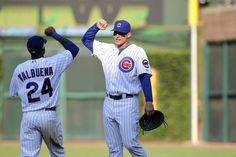 Luis Valbuena and Anthony Rizzo celebrate the Cubs' 3-2 win over the Astros