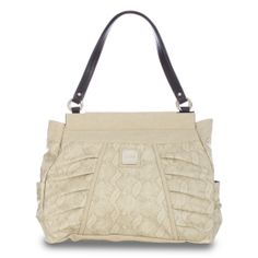 *Miche Canada* It's easy to picture this beautiful confection wandering in the bohemian areas of San Francisco or out for a day of shopping along Chicago's Miracle Mile. The Farrah Shell for Prima Bags has it all—it's utterly sophisticated yet at the same time flaunts an undeniable sense of attitude! Smooth light cream snake-patterned faux leather is given an edge with perfectly pleated detail.