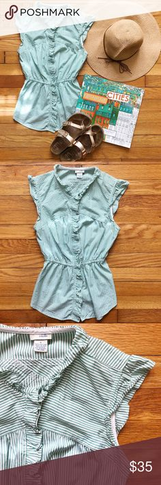 "🌿 Saccharine Spring Striped Blouse Sleeveless green pinstriped button-down blouse by Odille for Anthropologie with feminine ruffled placket, collar, and cap sleeves.  • Excellent gently used condition. • 100% cotton, but recommended as dry clean only. • Elastic waist stretches flat from 12-15"", flat bust measures 15"", length is 23"". • Bundle 3+ items and receive 20% off! Anthropologie Tops Blouses"