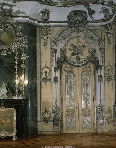 """Ornate door and fireplace of the """"Silver"""" concert hall, Neues Palais, Sanssouci Gardens (1765).  Palace Neues Palais, Potsdam, Germany"""