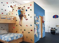 Love this idea! Climbing wall with bunk beds.