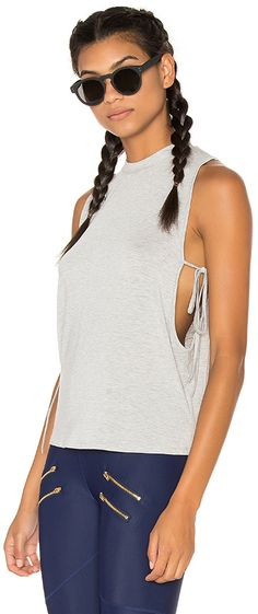 Lovers + Friends WORK by Lovers + Friends Leisure Tank in Gray. - size L (also in ) Lovers + Friends WORK by Lovers + Friends Leisure Tank in Gray. - size L (also in ) 95% modal 5% spandex. Side tie closures. LOVF-WM32. LFAW2005WH. Constantly inspired by the laid back Los Angeles lifestyle in which the brand was founded, Lovers + Friend exudes ease and wearability, creating an effortlessly chic look that is California cool.