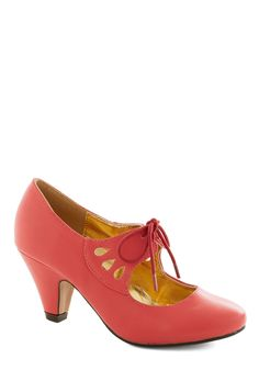 On the Bright Foot Heel in Coral. When you start your week laced into these peppy pink heels, you set the stage for great things to come! #coral #modcloth