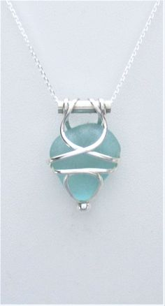 Sea Glass Jewelry - Sterling Caged Aqua Sea Glass Necklace by SignetureLine on Etsy #seaglassearringsideas #seaglassnecklace #seaglassideas