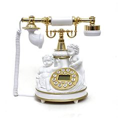 LNC White Angles Statue Retro Vintage Antique Style Push Button Dial Desk Telephone Phone Home Living Room Decor LNC http://www.amazon.com/dp/B00U2K8H0I/ref=cm_sw_r_pi_dp_6YgFwb177W15H