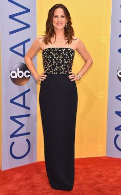 Jennifer Garner from CMA Awards 2016 Red Carpet Arrivals  Before serving as a presenter, the A-list actress opts for a classy and sophisticated Jenny Packham dress.