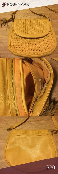 "Mustard yellow cross body Ecote purse Liner has some signs of use, lights marks, see photos. Outside of bag is in great condition: no noticeable signs of wear. Puchased from Urban Outfitters. Strap is 47"" at longest length. 10.5"" x 9"" x 2.5"" Ecote Bags Crossbody Bags"