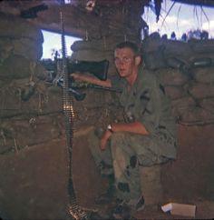 1st Cavalry Division soldier in a bunker at LZ Ichiban manning the M60. ~ Vietnam War