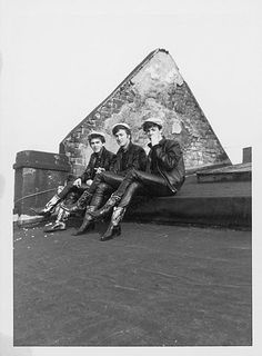 George Harrison, John Lennon and Paul McCartney lounging on the roof of Hamburg's Top Ten Club in 1961.