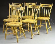 """THUMB BACK WINDSOR CHAIRS IN YELLOW PAINT.  Mid 19th century. Having straight crest rail mortised into carved and turned uprights with turned spindles having a carved shaped seat on simple bamboo turned base. Having yellow paint with painted banding and fruit and floral elements. SIZE: 34"""" H, 15-1/2"""" L, 15-3/4 D"""