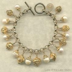 Cultured pearl and 24k gold vermeil charm bracelet.