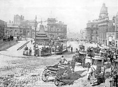 Fitzalan Square looking towards Fitzalan Market Hall and Haymarket 1895-1915, Cab Stand, foreground, Omnibus Waiting Room, centre, General Post Office (Haymarket), Birmingham District and Counties Banking Co. Ltd. and Wonderland entertainment boo
