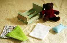 DIY baby bear's bed with a pre-made mini crate and stuffed animal