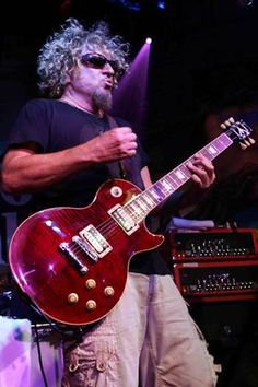 Sammy Hagar's signature Les Paul played by the Red Rocker himself. I've never actually played it but I'll probably still get it one day. Red Rocker, Sammy Hagar, Les Paul Guitars, Gibson Guitars, Jimmy Page, Gibson Les Paul, Cool Guitar, Long Hair Styles, Musicians