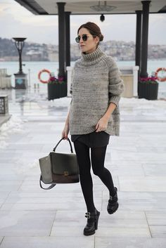 Istanbul #StreetStyle: Gala Gonzalez wearing a Guess skirt, Cos jumper, Prada shoes & Céline Trapeze bag with vintage RayBan