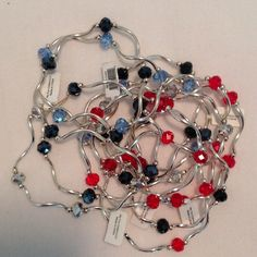 12 Silver Bracelets! FINAL PRICE 4 each red & black. 2 blue. 2 clear. For smaller wrist. Stretchy. New. Tags. No trades. Jewelry Bracelets