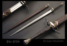 """""""Du - Sith"""" civilian longsword This is a very light fast sword, with a 50% distal taper. The grip is wenge and the pomel and guard are silicon bronze, with sterling silver 'genius cuculatus' inset in the pomel. The Scabbard is carved of Wenge and is lined with close sheared sheep fleese, the fittings are cast bronze. The blade is 1084 steel. www.powning.com"""
