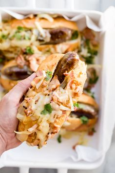 Juicy bratwurst hoagies covered in bacon, onions and melted pepper jack cheese