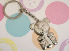 Silver teddy bear keychain - Cute and cuddly teddy bear keychain favor. These adorable teddy bear key chains are perfect for any baby theme party, each keychain has a silver chrome teddy bear charm attached to a metal key ring. http://www.favorfavorbaby.com/p-DCKC646.htm