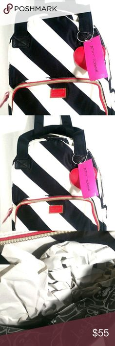 BETSEY JOHNSON BLACK AND WHITE 2 in 1 BACKPACK BETSEY JOHNSON BLACK AND WHITE 2 in 1 BACKPACK  SIZE L   Retail: $125.00 •Fashion Forward Back Pack •Can Hold Everything! •Can use for laptop or Overnight or Baby bag •Anywhere you go in style Dimensions: 10.5x8x15 handle drop 10in BETSEY JOHNSON Bags Backpacks